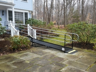The front entrance of this Wilton, CT home is now wheelchair accessible with an Amramp modular wheelchair ramp.