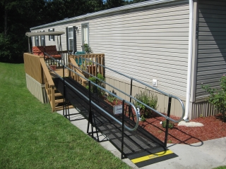 Amramp provides access with a wheelchair ramp from the back deck of this home in Knoxville, TN