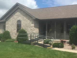 Amramp Southeastern Wisconsin provided access to the front entrance of this Prarie Du Sac home with an Amramp modular wheelchair ramp.