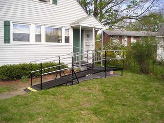 Residential installation of a 22-foot-long Amramp wheelchair ramp makes this Springfield, MA home accessible.