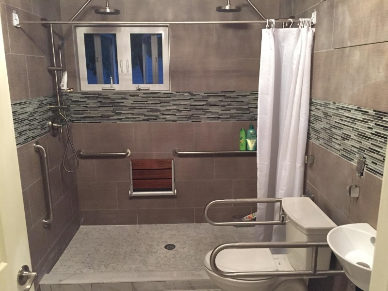 Dave Hoglund and his Amramp team made modifications to the bathroom of this Bethlehem, Pennsylvania home to make it accessible with grab bars, hand-held shower heads and a fold-up shower seat.
