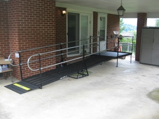 This wheelchair ramp provides safe and dry access under the carport for the resident of this Johnson City, TN home