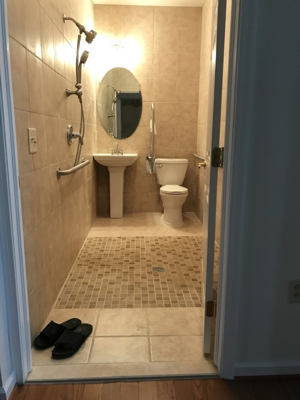 Amramp Northeast PA renovated this bathroom to be fully accessible for this Whitehall, PA resident with a zero step shower and grab bars.