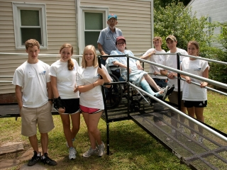 Ivy Street students volunteer with R.A.M.P.S to help install an Amramp wheelchair ramp for a senior in their community.