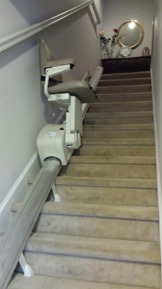 An indoor stair lift provides access to the upper level of this home in Salisbury, NC.