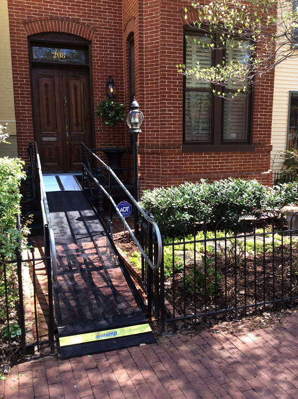 Amramp makes the front entrance of this lovely Capitol Hill home in Washington, DC wheelchair accessible with a one day rental modular wheelchair ramp for a special event.