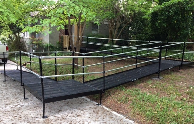 The Amramp South Carolina team was able to overcome the hilly terrain on this Greenville, SC property and provide an accessible solution from the side entrance to the driveway with this wheelchair ramp.