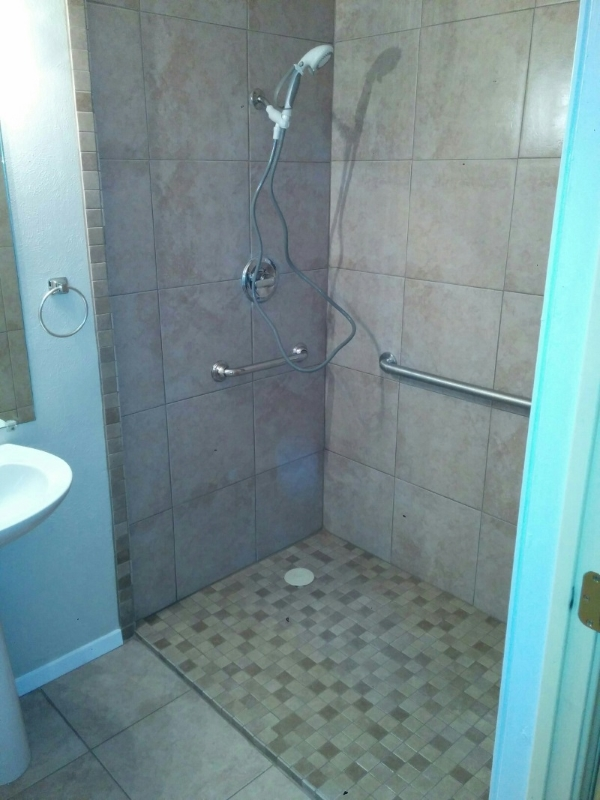 The Amramp Dallas/Fort Worth team completed a bathroom remodel project with the Community Services Organization for a family in DeSoto, Texas which included adding a zero step shower with grab bars and a hand-held shower. The family ecstatic. Their son is now able to access the bathroom and shower more easily.