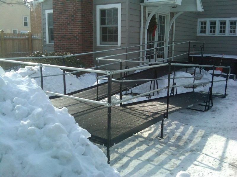 Amramp's steel, mesh platforms do not accumulate snow or moisture as this residential ramp installation in Buffalo shows.