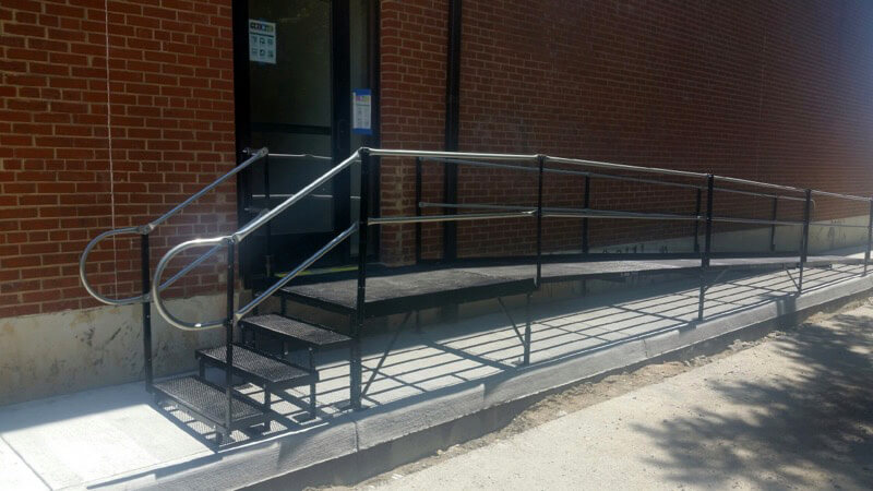 The Richmond Amramp team installed an Amramp ramp with platform and stairs at the Caritas center in Richmond, Virginia, allowing safe access in and out of the building.