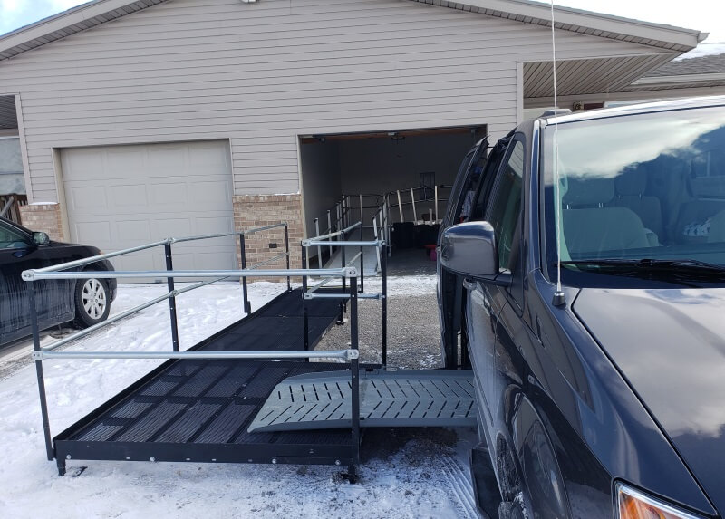 This tenant in Cass City, MI displaced from her own home because of accessibility issues, is plagued with an icy or muddy mess on any given day. After a muddy fall, she spoke up and got the barrier free access she deserves. A 14 foot ramp and a 5x5 platform designed to work with her existing vehicle's ramp provide just that.
