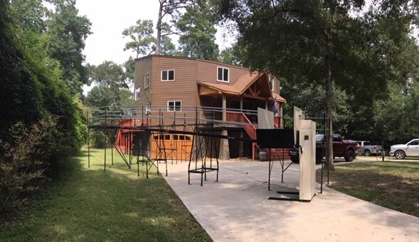 This 6' vertical platform lift and ramp set at a 10' height were installed for an injured worker in Cypress, TX. The client lives in a flood zone and his home is set 10' off the ground. Leslie Morgan and the Amramp Texas team had one day's notice to help him return home.