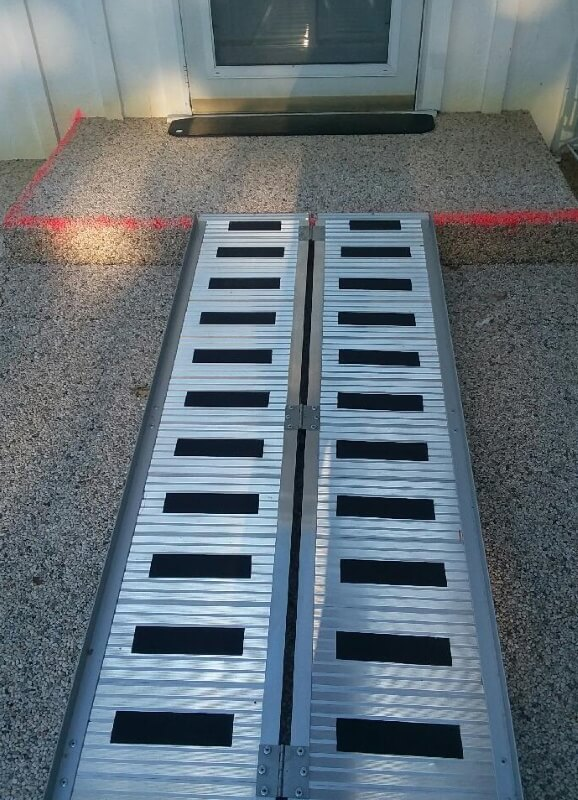 Amramp of Dallas/Fort Worth provided an affordable solution for this Dallas mother with the help of two portable ramps and a small concrete pour. They also improved her existing door threshold as it was too wide for her to cross safely.