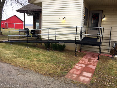 This Hudson, IN home is now wheelchair accessible after our Huntington, IN team installed this ramp to the entrance of a customers home