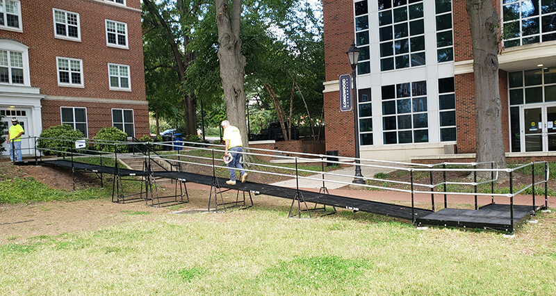 The Amramp team installed this commercial ramp at Longwood University in Farmville, Virginia. The ramp allowed access to the lawn area during a temporary construction project.