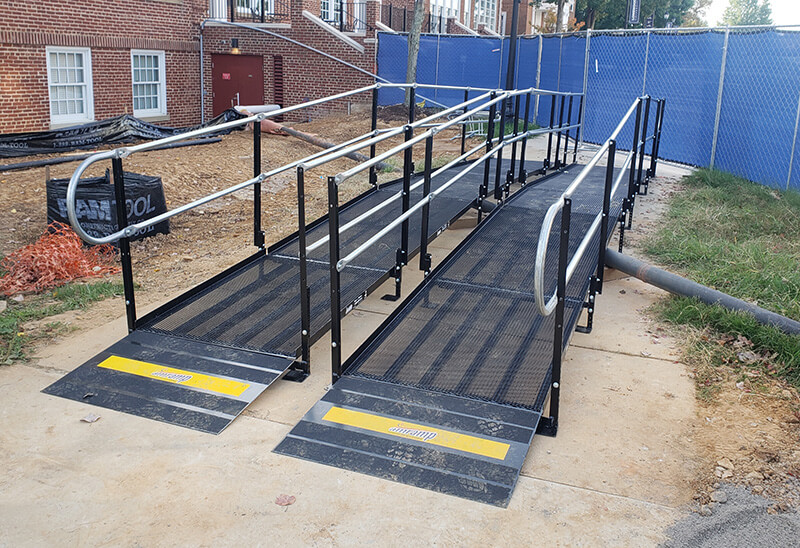 Two Amramp ramps were installed over a steam line during a construction project at Longwood University in Farmville, Virginia. The double ramp set up allowed pedestrians safe access over the pipes.