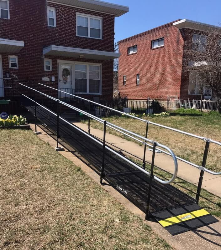 This wheelchair ramp was installed at a home in the Reisterstown Rd Neighborhood in Baltimore, MD, allowing this senior to safely exit her home.