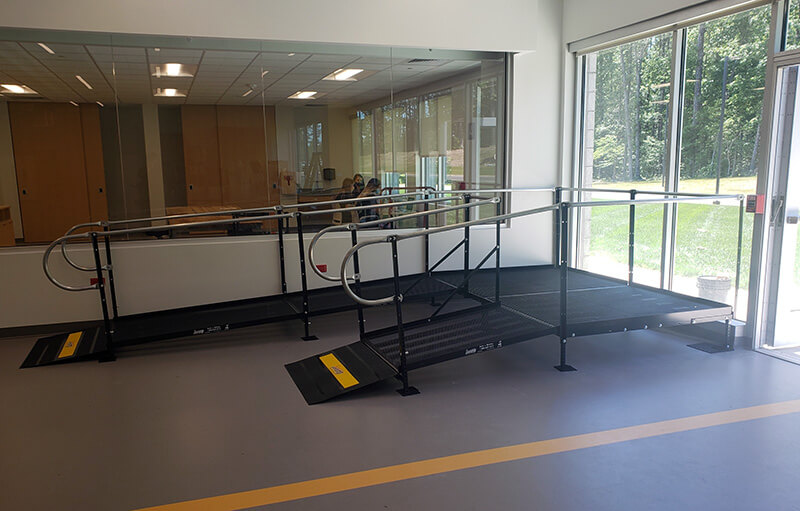 An Amramp ramp installed at Sheltering Arms Institute in Goochland, Virginia. This Amramp ramp is located in the rehabilitation/therapy gym allowing patients to practice moving and negotiating along a ramp before returning home.