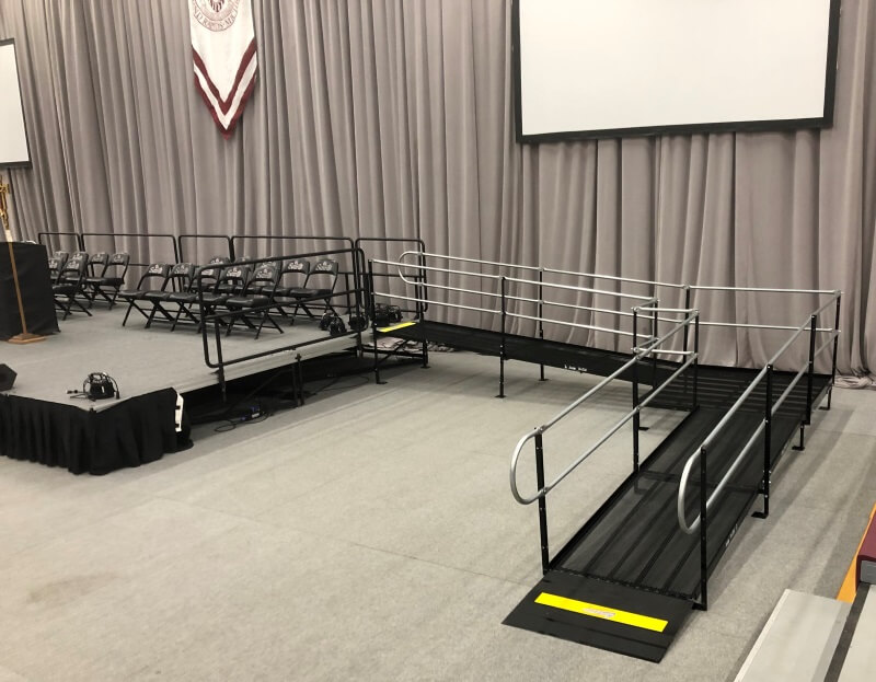 Amramp provides twin college graduation ramps for Aquinas College in Grand Rapids, Michigan. These students may not always need a ramp, but they will experience many ups and downs as they commence on the next path of their life's journey. Who knows, some of them may even choose to pursue a career in the accessibility industry.