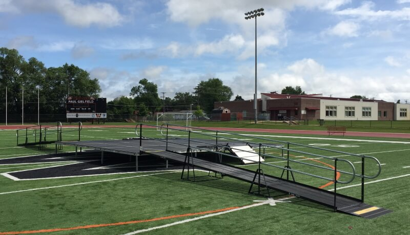 This outdoor graduation at Winona High School is outfitted with wheelchair ramps from Amramp Minnesota.