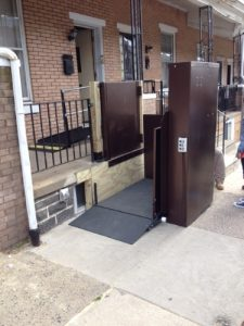 This Philadelphia, PA home did not have enough room for a wheelchair ramp, but this outdoor vertical platform lift provides wheelchair access to the front entrance.