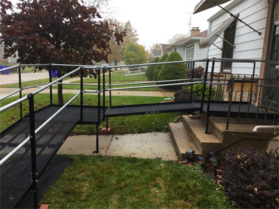 A soggy Wisconsin fall day did not hinder the Amramp Southeastern Wisconsin team from their morning installation of this wheelchair ramp in Kenosha Wisconsin. As the team finished up the installation for the client to return home a neighbor stopped by to inspect the work. Looks like there may be a bit of ramp envy in the neighborhood. Amramp Southeastern Wisconsin is making life accessible no matter the weather!