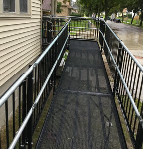 Sometimes the ramp is too big for the camera lens! When a family in Milwaukee suddenly had their contractor cancel their ramp with less than two weeks until their daughter was to discharge from the hospital, Amramp Southeastern Wisconsin was able to lend a hand. Without this ramp their daughter would have been discharged to a nursing home. With this ramp in place she came straight home. She even drove her power wheelchair up the ramp her first day home.