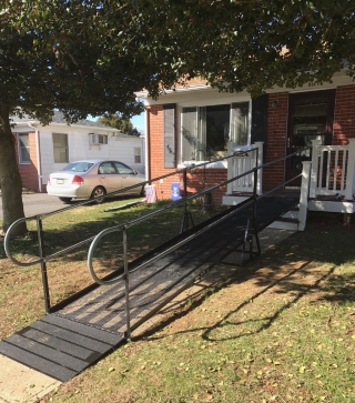 A residential wheelchair ramp provides access for this Middletown, DE home.