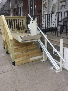 This inclined platform lift was installed by the Amramp Greater Philadelphia team, making the home's front entrance now wheelchair accessible.