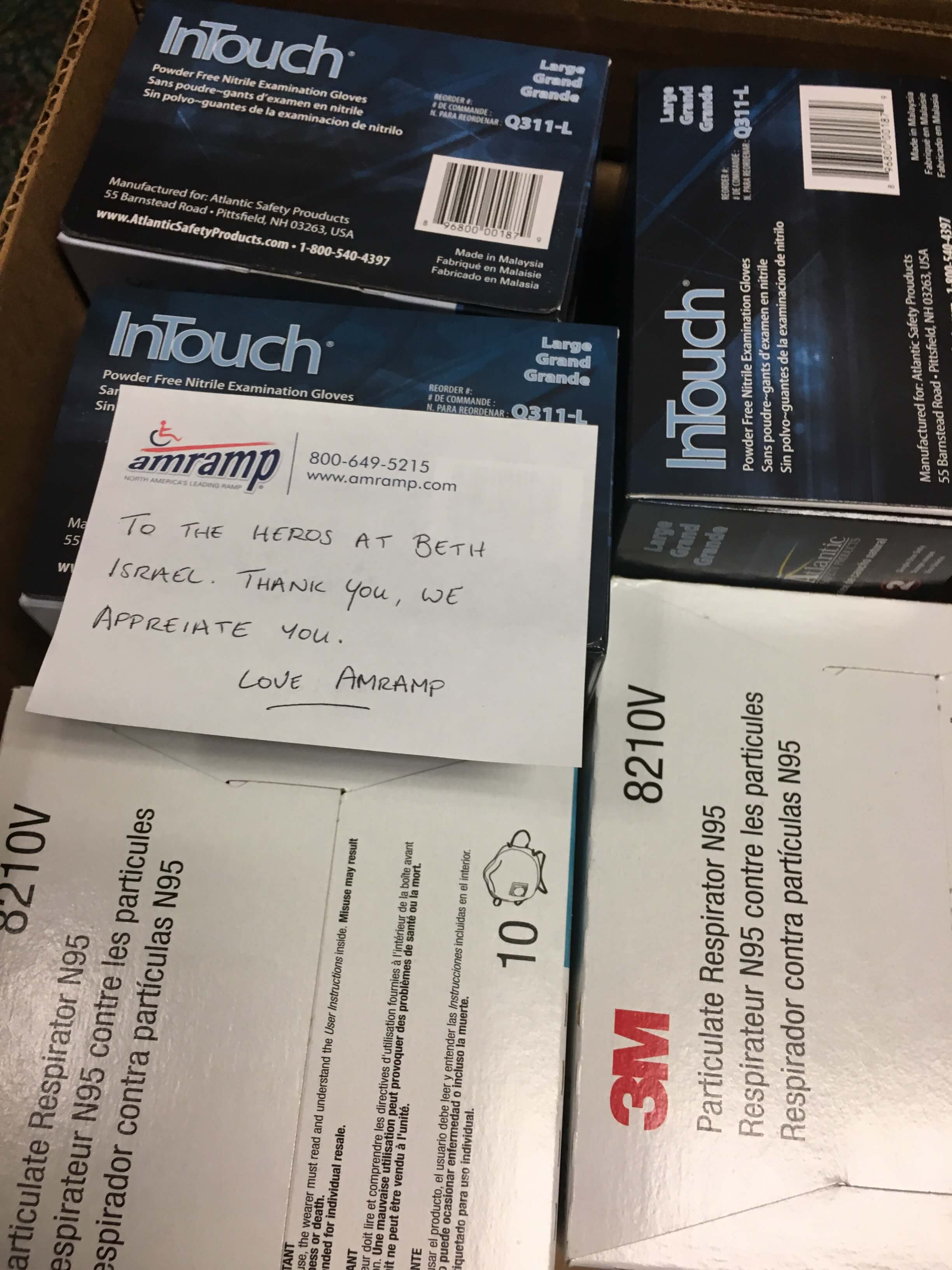 Box containing gloves and masks donated by Amramp to Beth Israel Hospital