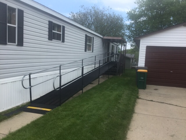 Amramp Southeastern Wisconsin was called on Friday about installing a wheelchair ramp in Oak Creek, WI. The client had hip replacement surgery and will come home this Friday. His children wanted to be sure he could easily come and go from his home during his recovery. The team installed the ramp this morning. His daughter was very happy with ramps appearance and his son was thrilled with the how quickly we got the job done.