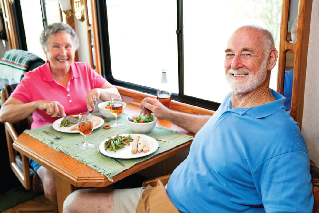 Senior man and woman eating a meal