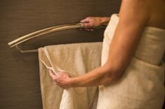 Decorative towel bar that is actually a grab bar.