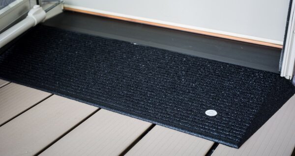 Rubber ramp at door threshold for wheelchair access