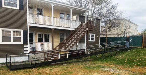 Amramp of Massachusetts traveled to a customers residence in Revere, MA in order to install this ramp over a sloped hill.